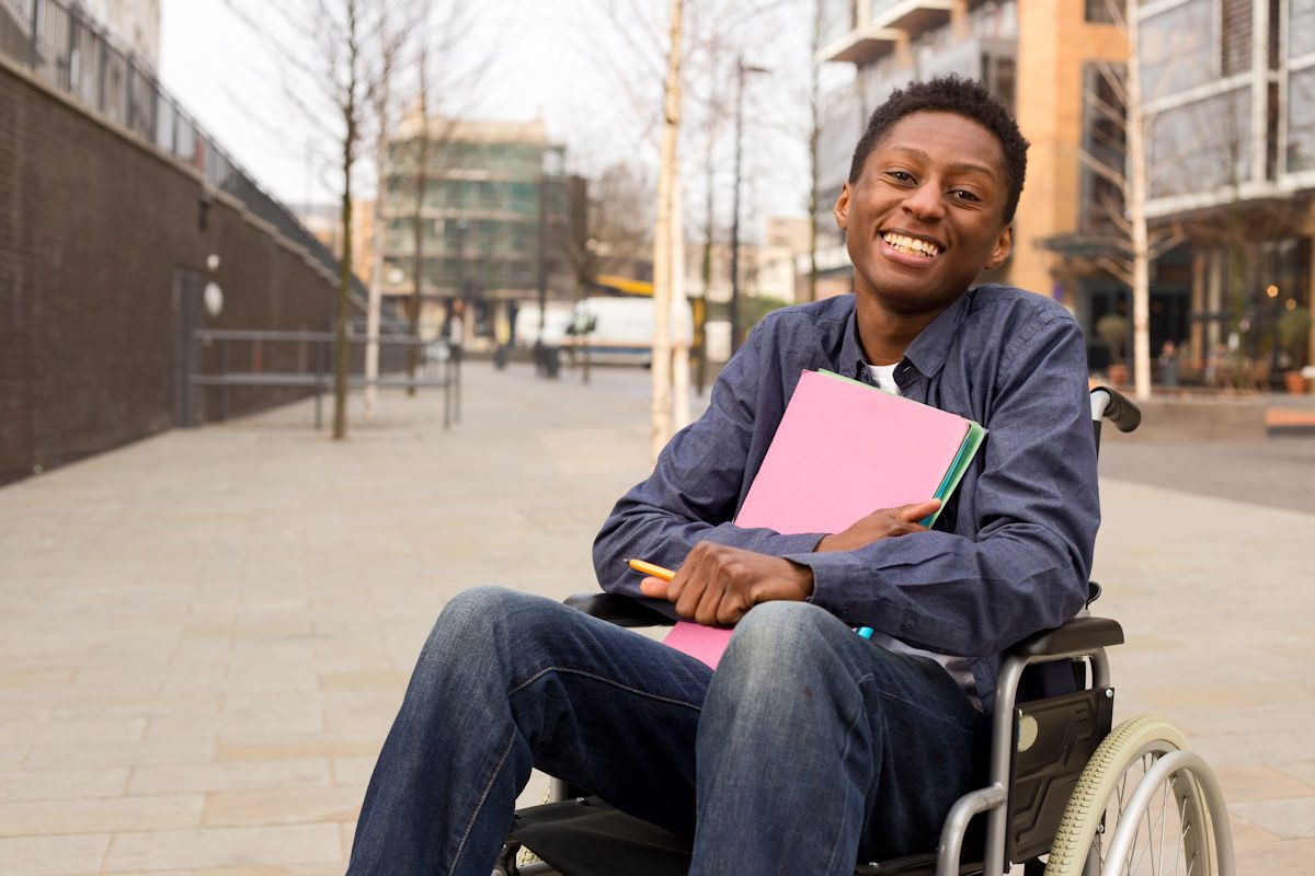 student in manual wheelchair